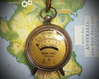 Steampunk / Dieselpunk Vintage Voltmeter on leather belt clip.