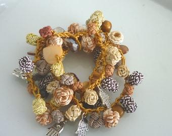 Moroccan art silk bead necklace/bracelet, golden and terracotta