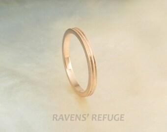 women's wedding band in 14k rose gold with delicate milgrain