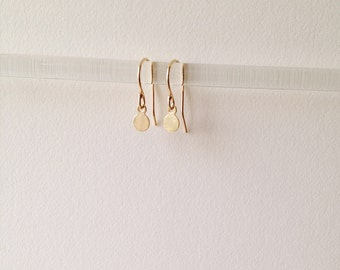 tiny gold dangles. solid 14k yellow gold. french hooks with tiny gold discs • • nigi sun earrings