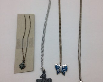 vintage necklaces in silver and turquoise and two other pendants