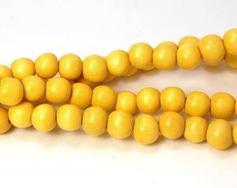 10mm Yellow Wood Beads -16 inch strand