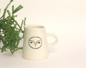 Porcelain creamer with face