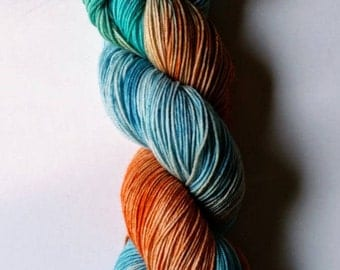 Kingfisher: hand dyed variegated Merino sock yarn by Star Fiber Studio