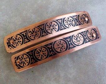 Small etched copper hair barrettes. Pair of hand etched metal hair barrettes with five patterned circle design on antiqued copper.