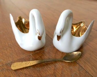 Salt and pepper pots. Pair of delicate porcelain swans with gold inside and spoon