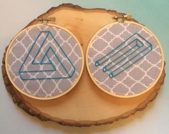 Two Framed Optical Illusion Handmade Embroideries On Gray Quatrefoil Fabric, Finished Piece