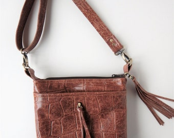Brown leather crossbody bag in crocodile embossed leather.  Shoulder bag in brown reptile embossed leather.