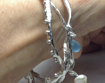 Twisted sterling silver bangle with seaglass and pearls