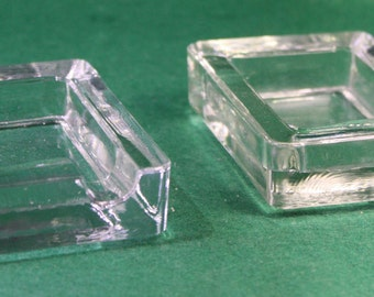 Pair of vintage stackable molded glass geometric ashtrays