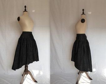 avant-garde black silk skirt