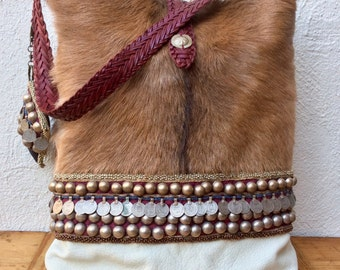 "Handmade bag or goat fur with ""tribal"" details"