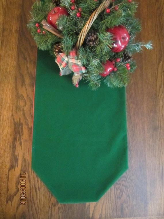Green velveteen reversible table runner ready for Christmas holidays