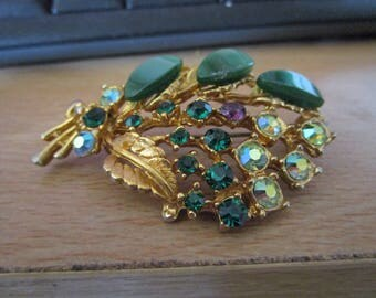 """vintage goldtone floral brooch with lucite,rhinestone,selected deep green stones 2.1/2""""across"""