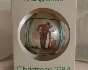 """Vintage Schmid Norman Rockwell 1984 """"Chilling Chore"""" Glass Ball Christmas Ornament"""