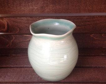 Sweet little light green bud vase