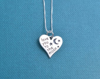"Little girl's heart shaped Love You To the Moon and Back necklace in sterling silver on a 14"" sterling silver box chain. Moon and Back"