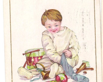 Antique Christmas Postcard 1916 Stetcher Litho Co. Embossed Boy Emptying Christmas Stocking  C40