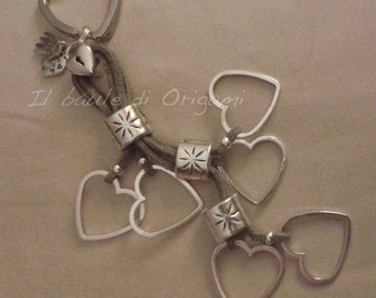 Heartfall jewel keychain a cascade of metal hearts and smooth suede string jewel keychain