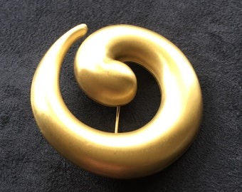 Vintage Monet satin goldtone swirl brooch. signed Monet