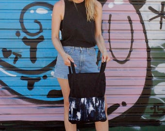 stylish deep blue backpack with pockets in shibori style