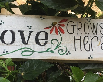 Love grows here painted sign