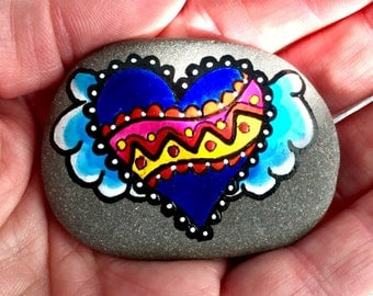True blue / painted rocks /painted stones / rock art / heart rocks / winged hearts / tribal art / hand painted rocks / stones