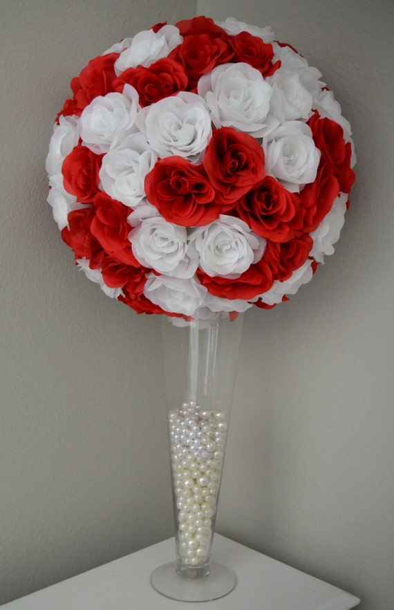 Red and white flower ball wedding centerpiece kissing
