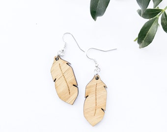 Earrings hanging wood feathers cutout bamboo plywood and silver hypoallergenic surgical steel drop hooks dangle with feather design