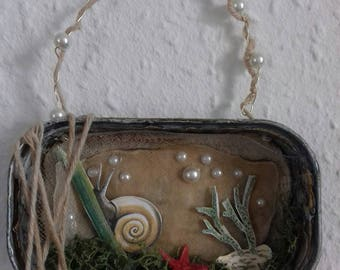 altered tin art. sea snail. mixed media,collage,assemblage art. wall art. whimsical.