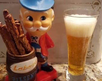 Labatt's pilsener beer advertising man, figure, 1960