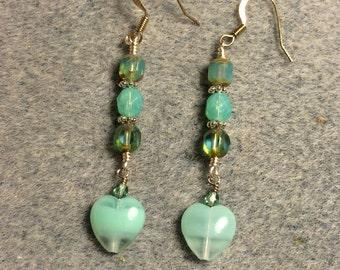 Seafoam blue green Czech glass heart bead dangle earrings adorned with blue green Czech glass beads.