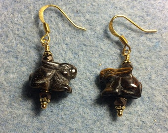 Small brown tigereye gemstone rabbit bead earrings adorned with brown Chinese crystal beads.