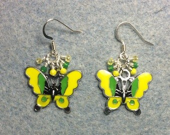 Yellow and green enamel butterfly charm earrings adorned with tiny dangling yellow and green Chinese crystal beads.