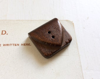 Carved wood button 1940s novelty button