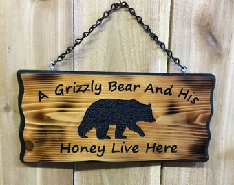 A Grizzly Bear and His Honey Live Here
