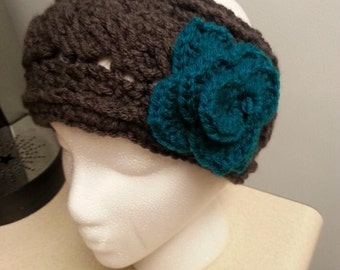 Cable stitch earwarmer with flower