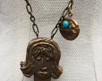 Bronze girl necklace with PMC charm and a turquoise stone