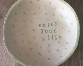 "Cup-empty pockets ""Enjoy your Life"""