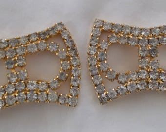 A pair of vintage rhinestone shoe clips.