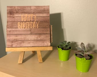 Happy Birthday Greeting Card on Rustic Wood Paper