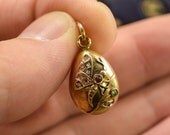 Antique Russian 14k gold Ruby Diamond  Green Garnet Butterfly Miniature Egg Pendant