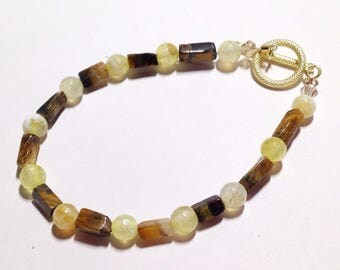 Golden Hue. Yellow fire Agate, Tigers Eye, sterling silver gold plated clasp gemstone bracelet.