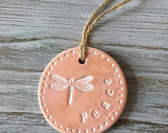Dragonfly Peace shabby chic air dry clay round hanging decoration on a hessian string. Peaceful, thoughtful gift