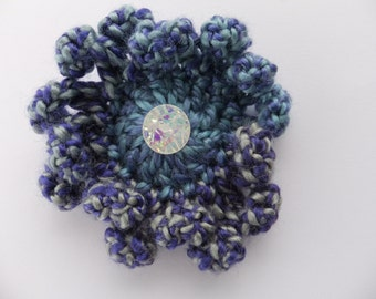 Blue and grey crocheted curly flower brooch with a stunning sparkly button