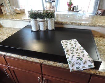 Matte Charcoal stove top cover with brass hardware