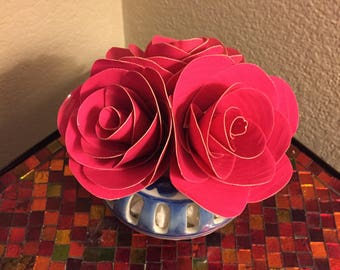 Stunning hot pink duct tape flower arrangement in charming blue and white vase