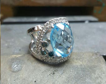 Blue topaz with white and blue diamonds