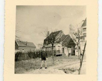 Vintage photo 'Back Yard King of the Hill' - vernacular photography snapshot, black and white picture, young boy
