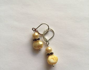 Yellow pearl and red rhinestone